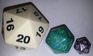 The d20 on the left is about the size of a baseball; the right-hand d20 is regualr size.